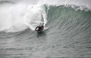 bodyboarder rides a wave