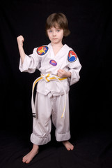 boy wearing martial arts outfit