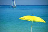 yellow umbrella turquoise sea poster