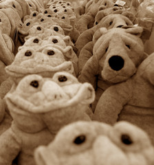 soft toy frogs and dogs in row in black and white