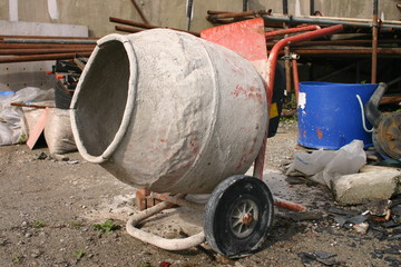 an old cement mixer in a builder's yard