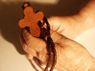 hands with a cross