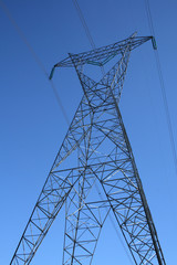 silhouette of a high voltage electricity pylon