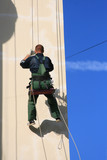 steeplejack climbing on a vertical wall