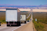 interstate delivery trucks on a highway poster