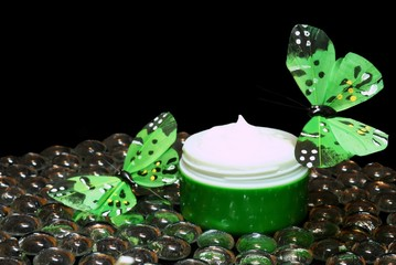 cosmetic cream and green butterfly