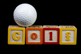 golf ball and spelled out poster