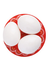 three egg on a plate.