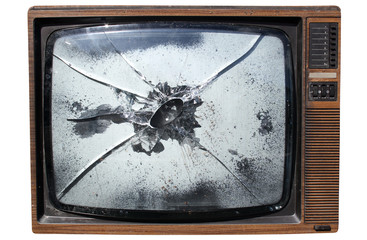 an old trashed tv with a smashed screen.