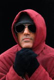 man in a red hooded sweatshirt poster
