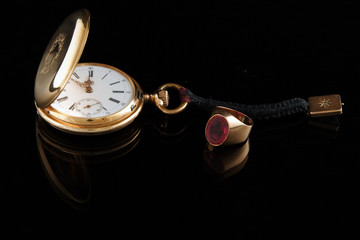 golden watch and man′s ring