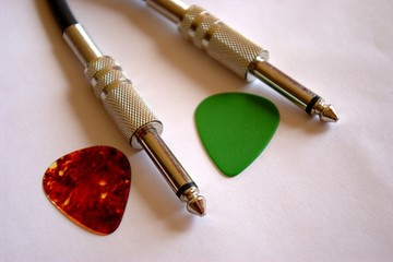 guitar picks and cable