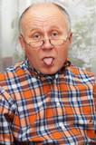 senior man showing his tongue. poster