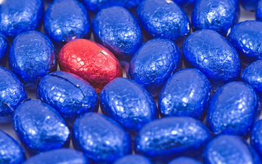 collection of blue easter eggs with one red egg