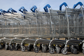 a row of shopping trolleys.