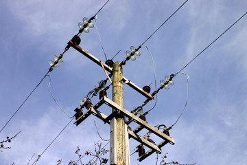wooden electricity pole and wires