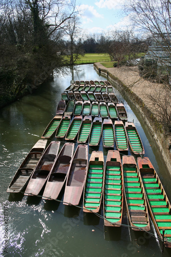 punts chained up on river