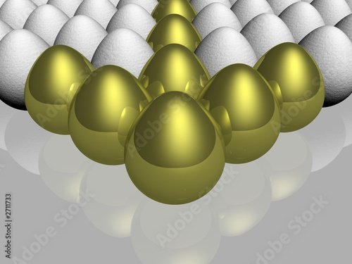 the gold egg among of some glass