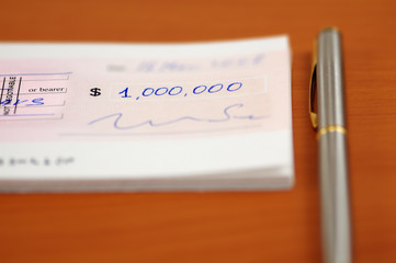 one million dollars cheque and a pen
