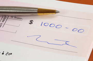 one thousand dollars cheque and a pen