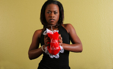 african american woman squeezing love pillow
