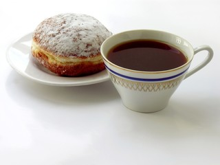 cup of black coffee and doughnut