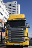 yellow truck-front in commercial area poster