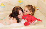 two women in bathtub poster