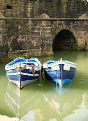 two blue fishing boats