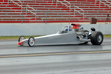dragster heads down the track