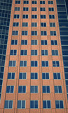 windows of a terracotta-colored building poster