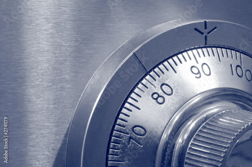 Leinwandbild Motiv closeup of combination safe lock