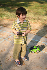 boy playing remote control car