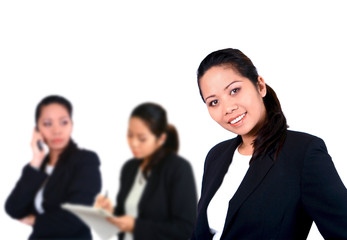 a businesswoman with women colleagues