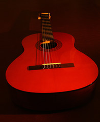 a red guitar in repose