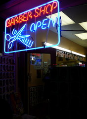 barber shop with neon sign