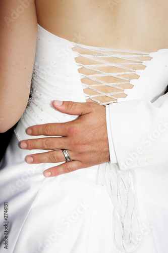bridegrooms hand on the back of his bride