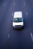 white light delivery truck on highway poster