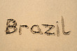 brazil, written on a sandy beach.