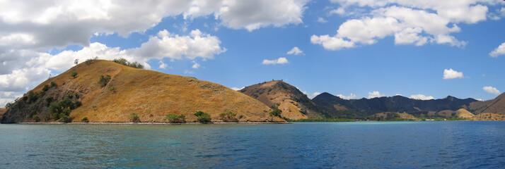 yellow mountains falling on the sea, komodo archipelago, indones