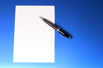 modern pen and sheet of paper