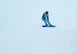 a girl riding down on the snowboard