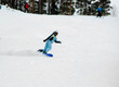 a girl riding fast on the snowboard 2