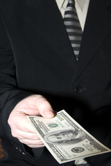businessman and one hundred dollars