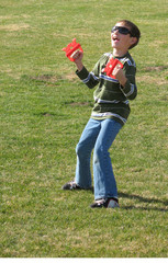 exuberant boy flying kite