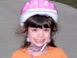 child wearing a bike helmet