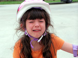 child wearing a bike helmet crying poster