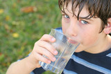 boy drinking a glass of water poster