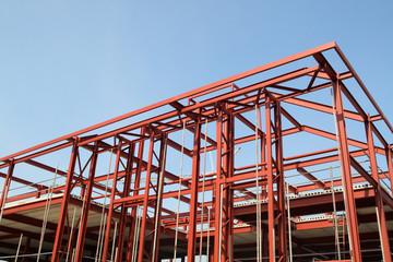 red steel building construction framework.