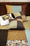 patchwork quilt and pillows poster